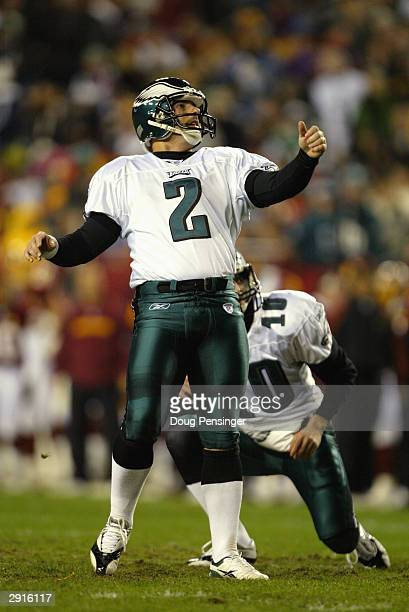 Placekicker David Akers and quarterback Koy Detmer of the Philadelphia Eagles watch the flight of a field goal attempt during the game against the...