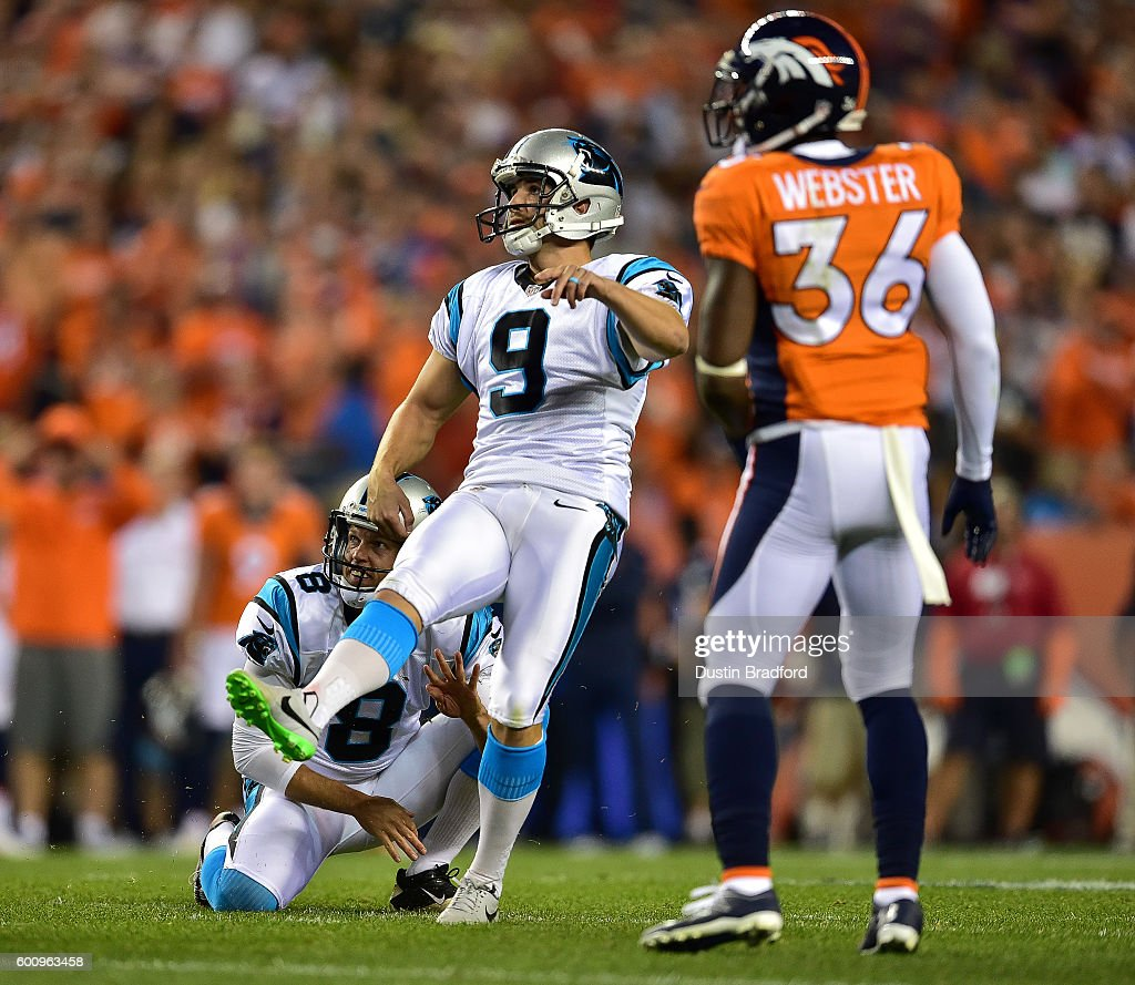 Placekicker Graham Gano #9 and punter Andy Lee #8 of the Carolina Panthers watch as an attempted game-winning field goal misses to lose to the Denver Broncos 21-20 at Sports Authority Field at Mile High on September 8, 2016 in Denver, Colorado.