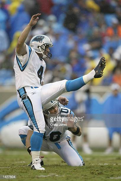 Placekicker John Kasay of the Carolina Panthers kicks out of a hold by punter Todd Sauerbrun during the NFL game against the Detroit Lions at...