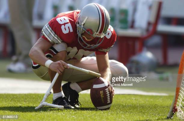 Placekicker Mike Nugent of the Ohio State University Buckeyes prepares the ball for a practice kick during the game against the Marshall University...