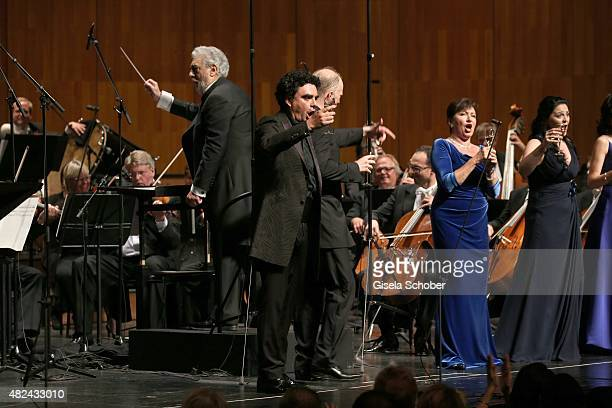 Placido Domingo and Rolando Villazon attend the 40 year stage anniversary of Placido Domingo during the Salzburg Festival on July 30 2015 in Salzburg...