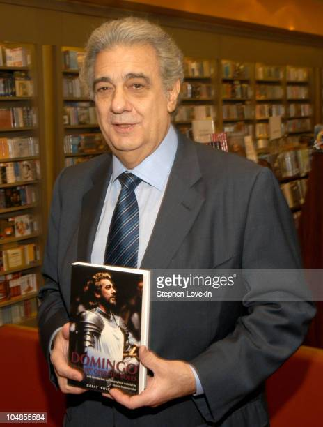 Placido Domingo holding his new biography during Placido Domingo Signs Copies of His New Biography Called 'Placido Domingo My Operatic Roles' at The...