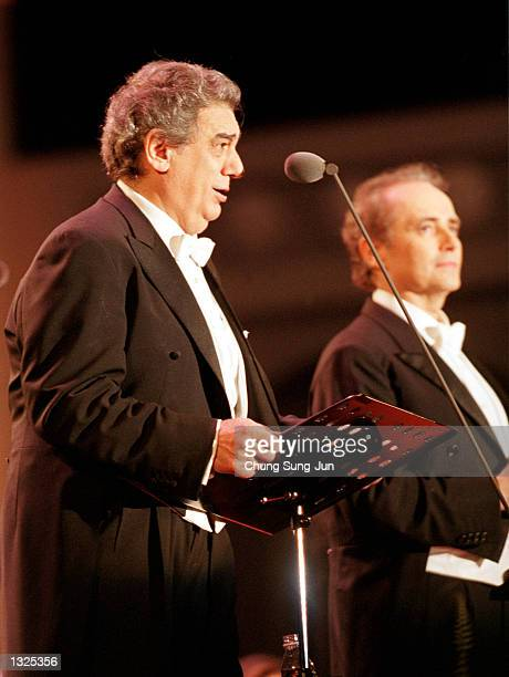 Placido Domingo left and Jose Carreras sing during the Three Tenors'' concert June 22 2001 at Chamsil Olympic stadium in Seoul The concert was held...