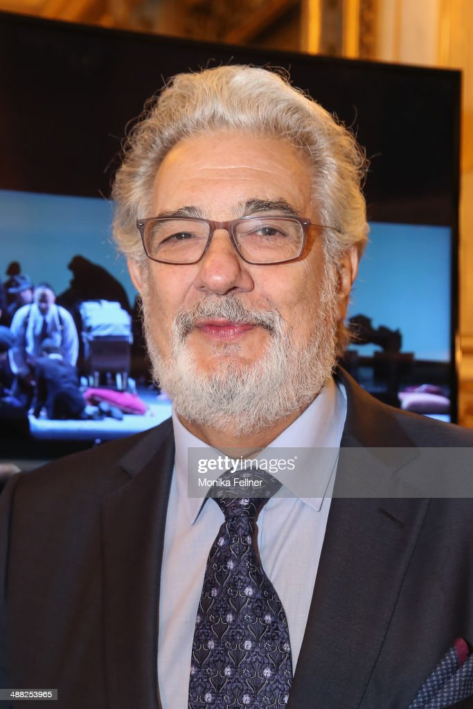 Placido Domingo poses in front of the UHD screen at the press conference at Vienna State Opera on May 5, 2014 in Vienna, Austria.