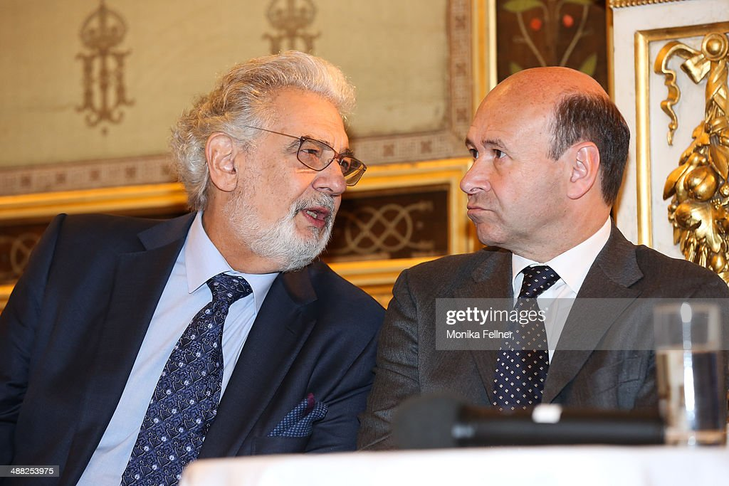Placido Domingo talks to the director of the State Opera Dominique Meyer at Vienna State Opera on May 5, 2014 in Vienna, Austria.
