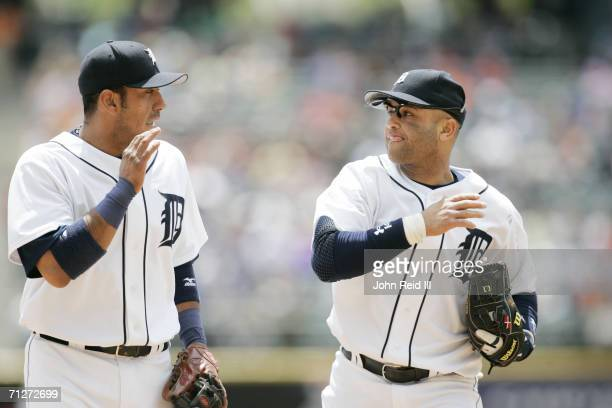 Placido Polanco and Carlos Guillen of the Detroit Tigers speak on the field during the game against the Minnesota Twins at Comerica Park in Detroit...