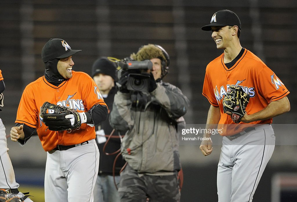 Placido Polanco #30 and Steve Cishek #31 of the Miami Marlins celebrate a win of the second game of a doubleheader against the Minnesota Twins on April 23, 2013 at Target Field in Minneapolis, Minnesota. The Marlins defeated the Twins 8-5.