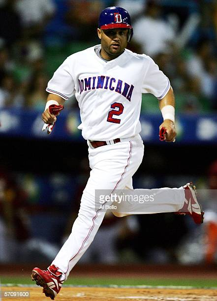 Placido Polanco of the Dominican Republic scores against Venezuela during Round 2 of the World Baseball Classic on March 14, 2006 at Hiram Bithorn...