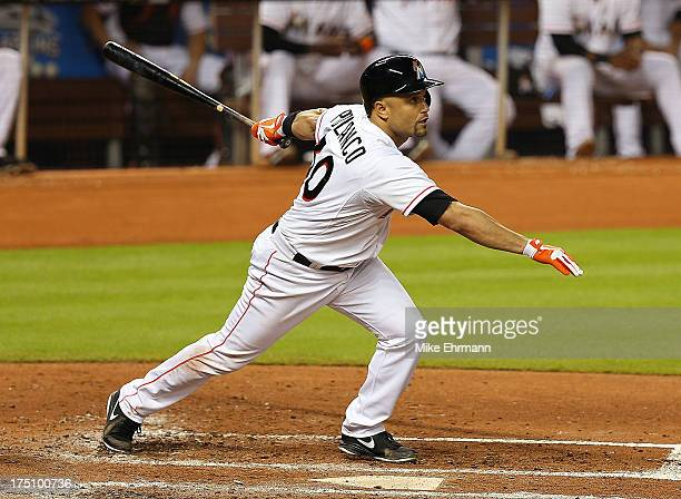 Placido Polanco of the Miami Marlins hits an RBI sacrafice fly during a game against the New York Mets at Marlins Park on July 31 2013 in Miami...