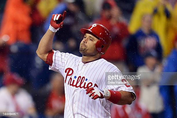 Placido Polanco of the Philadelphia Phillies celebrates a two run home run and his 2000th hits of his career during the game against the Houston...