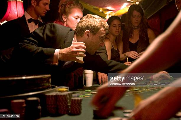 Placing bets on a table in The Lost Vagueness casino at the Glastonbury festival Enter into the theatre of glitzy sleaze in this decadent den of pure...