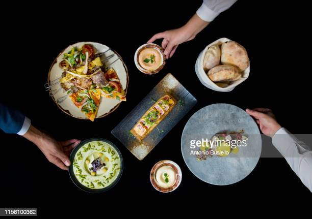 placing food - gourmet stock pictures, royalty-free photos & images