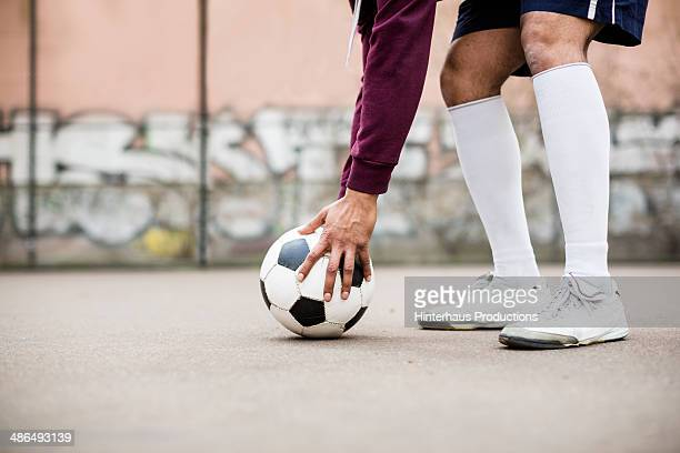 placing soccer ball - knee length stock pictures, royalty-free photos & images