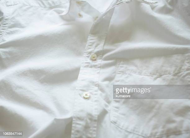 placket front of cotton shirt - garment stock pictures, royalty-free photos & images