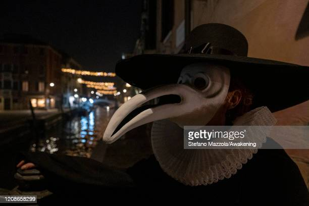 Plague doctors pose in Campo San Barnaba on February 25 2020 in Venice Italy The tradition of plague doctors dates back to 1630 when the plague...