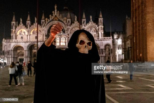Plague doctors pose in San Marco square on February 25 2020 in Venice Italy The tradition of plague doctors dates back to 1630 when the plague...