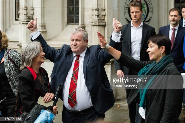 Plaid Cymru MP Liz Saville Roberts leader of the SNP in the House of Commons Ian Blackford and Green Party MP Caroline Lucas react outside the...
