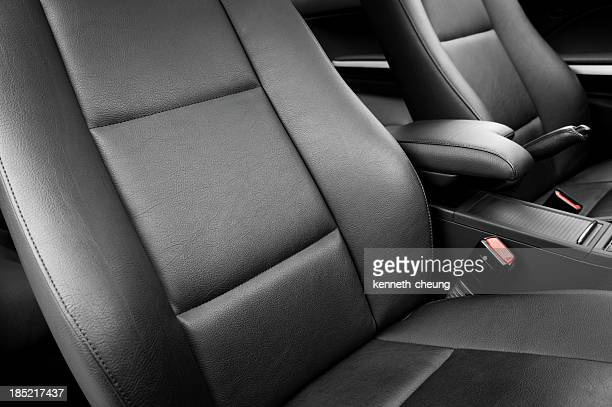 Plain black leather car seats in a new car