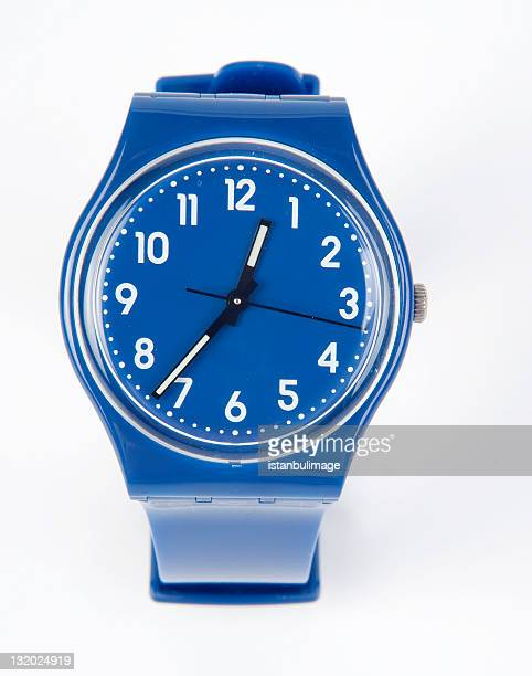 a plain blue and white wrist watch  - wrist watch stock pictures, royalty-free photos & images