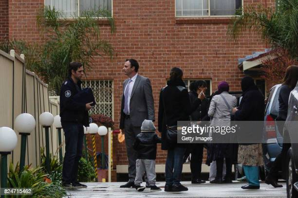Plain clothes and uniformed police are seen at an apartment complex in Sproule Street Lakemba Counter terrorism police raided four houses across...