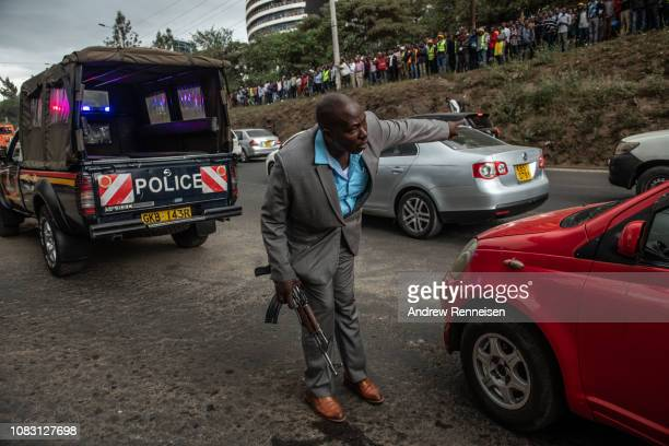A plain clothes police officer directs traffic on a highway near where terrorists attacked the Dusit Hotel on January 15 2018 in Nairobi Kenya A...