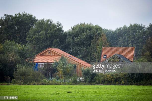 Plain clothes policeman inspects the farmhouse in a remote area of northern Netherlands' province of Drenthe, near the village of Ruinerwold, on...