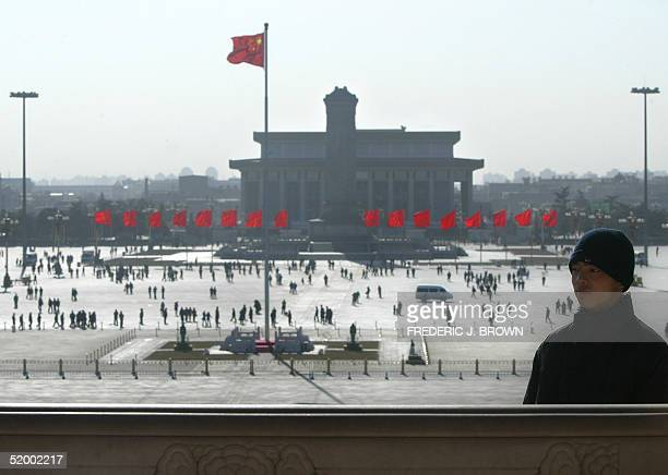 A plainclothed paramilitary guard stands on duty overlooking Tiananmen Square from the Tiananmen Gate rostrum 17 January 2005 in central Beijing...