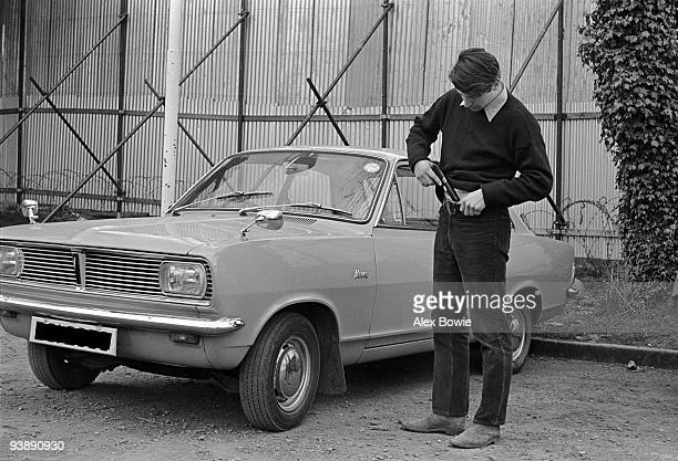 A plainclothes army intelligence officer secures his 9mm Browning HiPower automatic pistol before leaving a fortified army base in west Belfast 2nd...