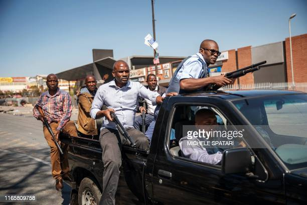 TOPSHOT Plainclothes members of the South African Police Service patrol the Johannesburg township of Alexandra on September 3 2019 after South...
