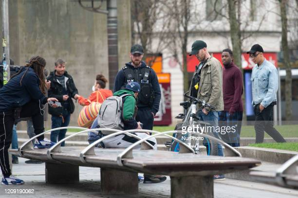 Plainclothes police officers confront a large group about their social distancing in Manchester's Piccadilly Gardens on Sunday 5th April 2020 The...