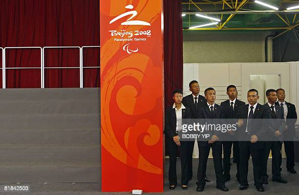 Plainclothes policemen stand guard during the visit of Chinese Vice President Xi Jinping to the Olympic equestrian venue in Hong Kong on July 6 2008...