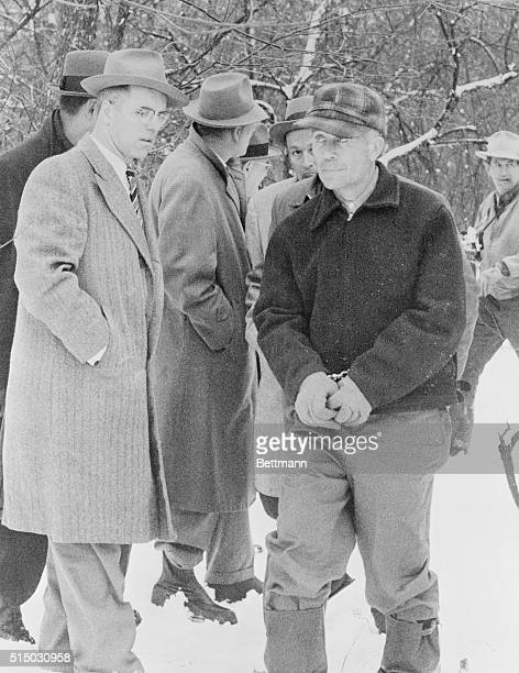 Plainsfield Wisconsin Edward Gein 51yearold farmer is surrounded by newsmen and officers on his 160acre farm after discovery of the mutilated and...