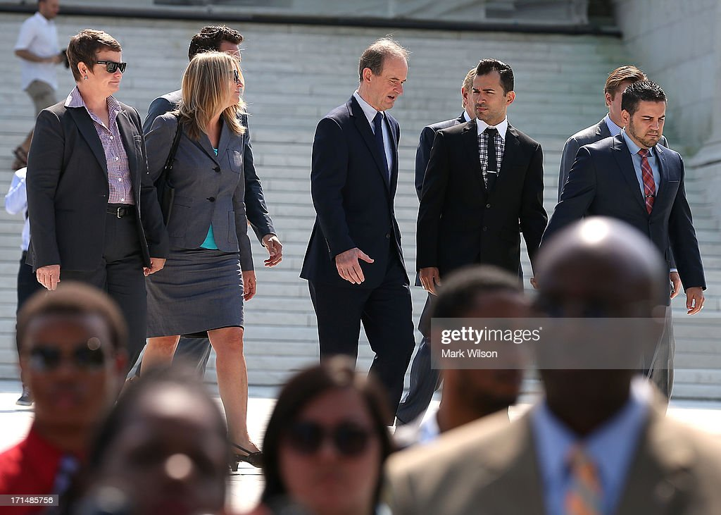 Plaintiff couple Sandy Steier (L), Kris Perry (2L), attorney David Boies (C), Paul Katami, (2nd-R) and Jeff Zarillo (R) walk away from the U.S. Supreme Court building, June 25, 2013 in Washington DC. Today the high court did not give a ruling on California's Proposition 8, the controversial ballot initiative that defines marriage as between a man and a woman.