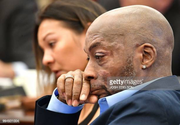 Plaintiff Dewayne Johnson listens as attorney Brent Wisner speaks about his condition during the Monsanto trial in San Francisco California on July...
