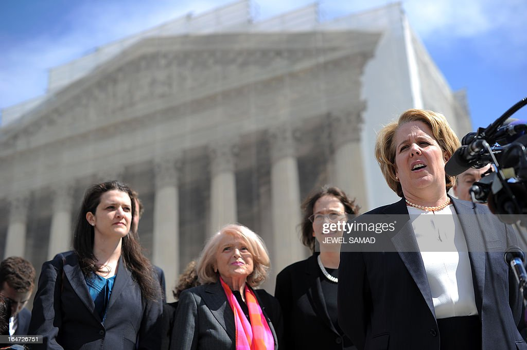 Plaintiff of the US v. Windsor case challenging the constitutionality of Section 3 of the Defense of Marriage Act (DOMA), 83-year-old lesbian widow Edie Windsor (C) looks on as her lawyer Roberta Kaplan (R) makes a statement to the media in front the Supreme Court on March 27, 2013 in Washington, DC. The US Supreme Court tackled same-sex unions for a second day Wednesday, hearing arguments for and against the 1996 US law defining marriage as between one man and one woman. After the nine justices mulled arguments on a California law outlawing gay marriage on Tuesday, they took up a challenge to the constitutionality of the federal Defense of Marriage Act (DOMA). The 1996 law prevents couples who have tied the knot in nine states -- where same-sex marriage is legal -- from enjoying the same federal rights as heterosexual couples. AFP PHOTO/Jewel Samad
