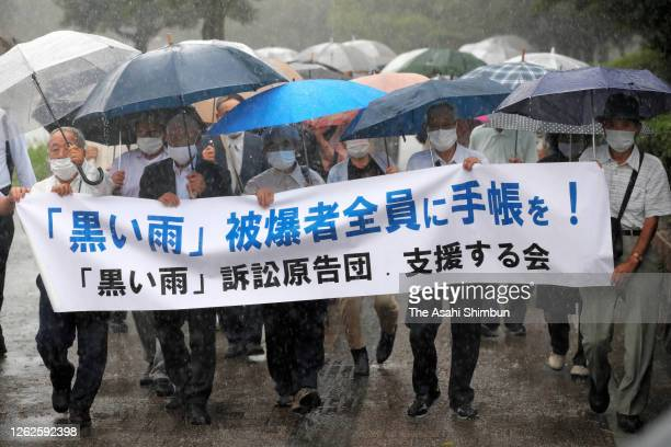 Plaintiff supporters march on for hearing the ruling by the Hiroshima District Court on July 29, 2020 in Hiroshima, Japan. A local court has issued a...
