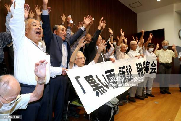 Plaintiffs and their supporters celebrate during a press conference following the ruling by the Hiroshima District Court on July 29, 2020 in...