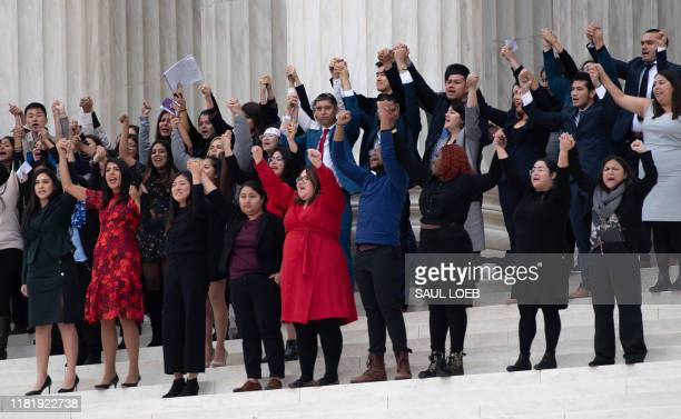 Plaintiffs come out of court as immigration rights activists hold a rally in front of the US Supreme Court in Washington, DC, November 12 following...