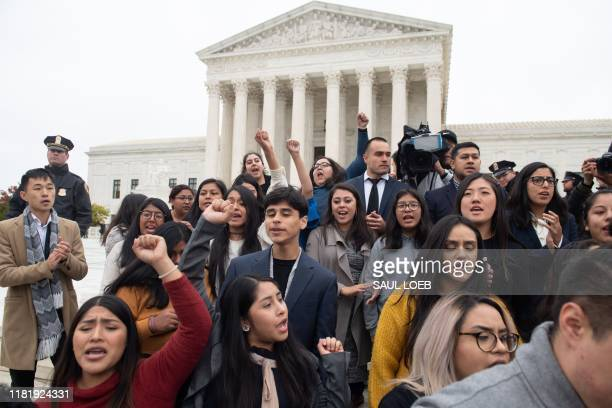 plaintiffs come out of court as immigration rights activists hold a rally in front of the US Supreme Court in Washington DC November 12 following...