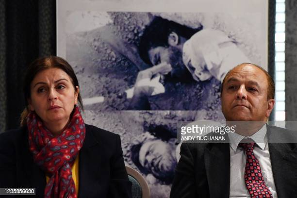 Plaintiffs Farzaneh Majidi and Reza Fallahi attend a press conference organised by The UK Representative Office of the National Council of Resistance...