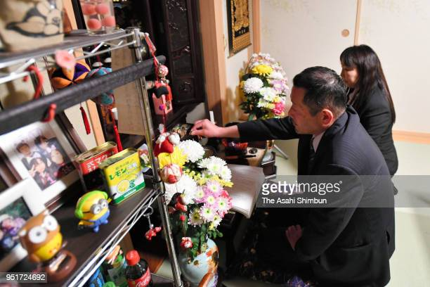 Plaintiffs Hiroyuki Konno and his wife Hitomi pray for their three children killed in the 2011 tsunami after the Sendai High Court's ruling on April...