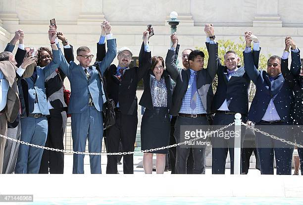 Plaintiffs in the marriage equality case raise their hands in celebration after a hearing at the Supreme Court of the United States on April 28, 2015...