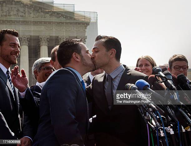 Plaintiffs Jeff Zarillo and Paul Katami kiss in front of the Supreme Court in Washington, DC on June 26, 2013. The Supreme Court ruled on the Defense...