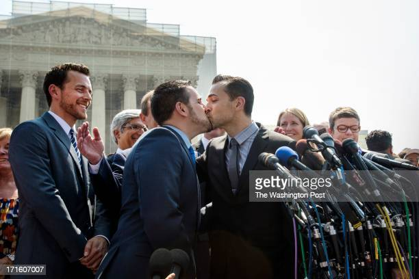 Plaintiffs Jeff Zarrillo, left, and Paul Katami kiss in front of the Supreme Court in Washington, DC on June 26, 2013. The Supreme Court ruled on the...