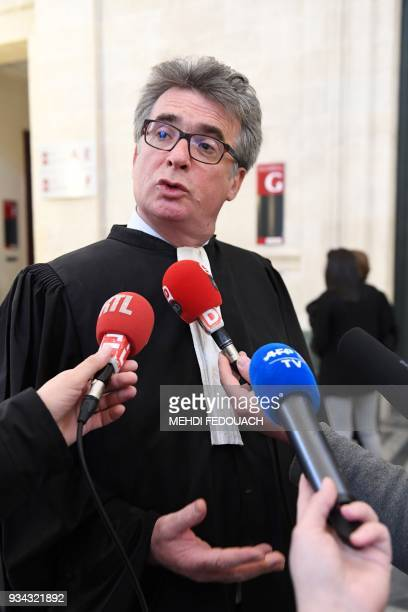 Plaintiffs' lawyer Jean Gonthier answers journalists' questions on March 19 2018 at Bordeaux's courthouse prior to the opening hearing of the trial...
