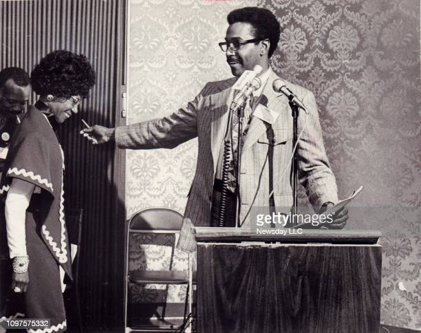 Donald Lee president of the New York State NAACP welcomes Rep Shirley Chisholm to the podium at the organization's state convention in Plainview New...