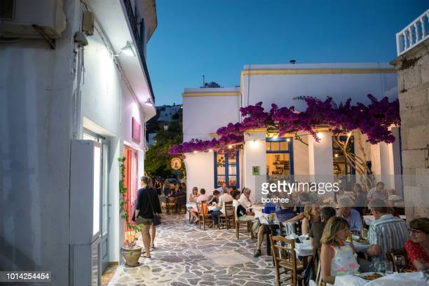 plaka village with shops and restaurants - greece stock pictures, royalty-free photos & images