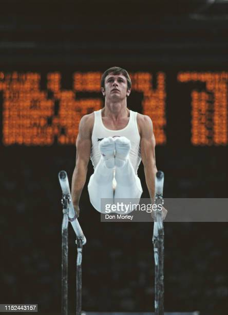 Plamen Petkov of Bulgaria performs during the Men's parallel bars competition on 25th July 1980 during the XXII Olympic Summer Games at the Palace of...