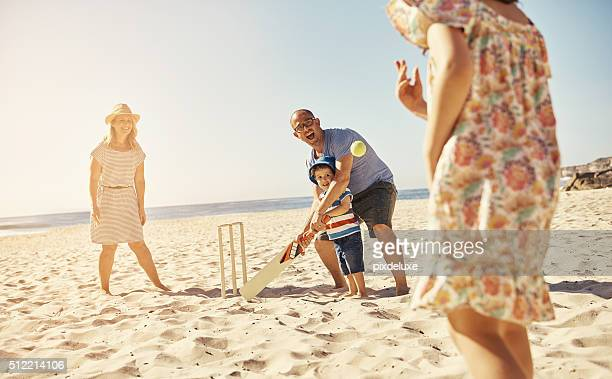 plan a fun day at the beach - cricket stockfoto's en -beelden