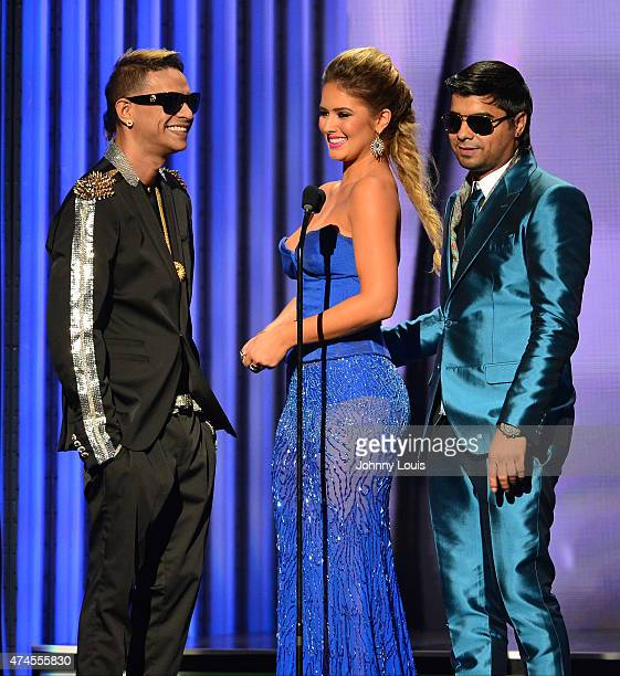 Plan B and Kimberly Dos Ramos onstage during the 2015 Billboard Latin Music Awards presented by State Farm on Telemundo at Bank United Center on...